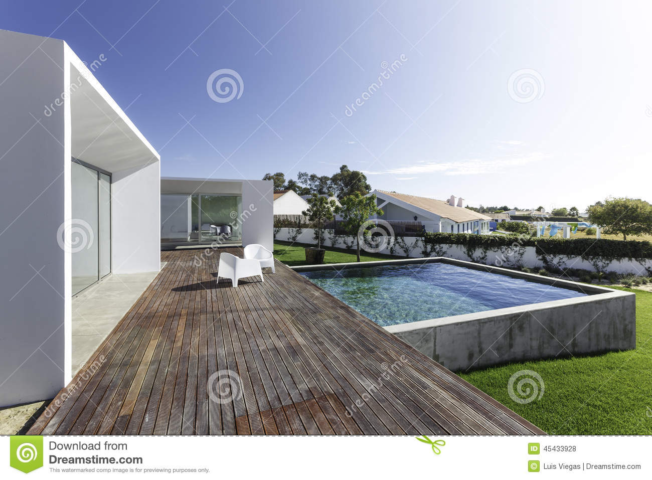 House With Garden Swimming Pool And Wooden Deck Stock Photo - House with garden and swimming pool