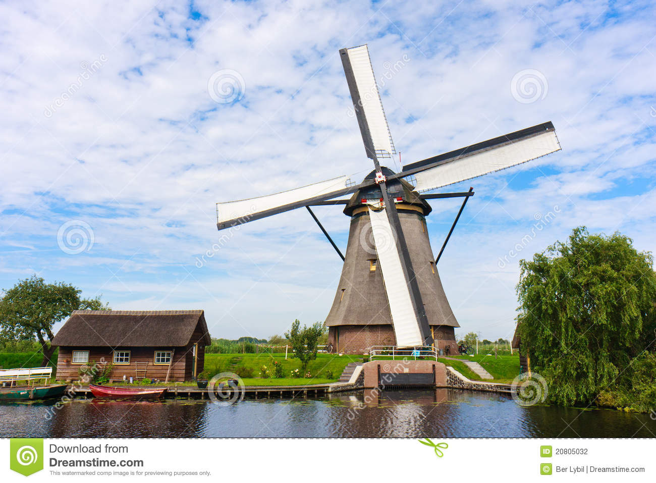 Traditional Dutch windmill with its house