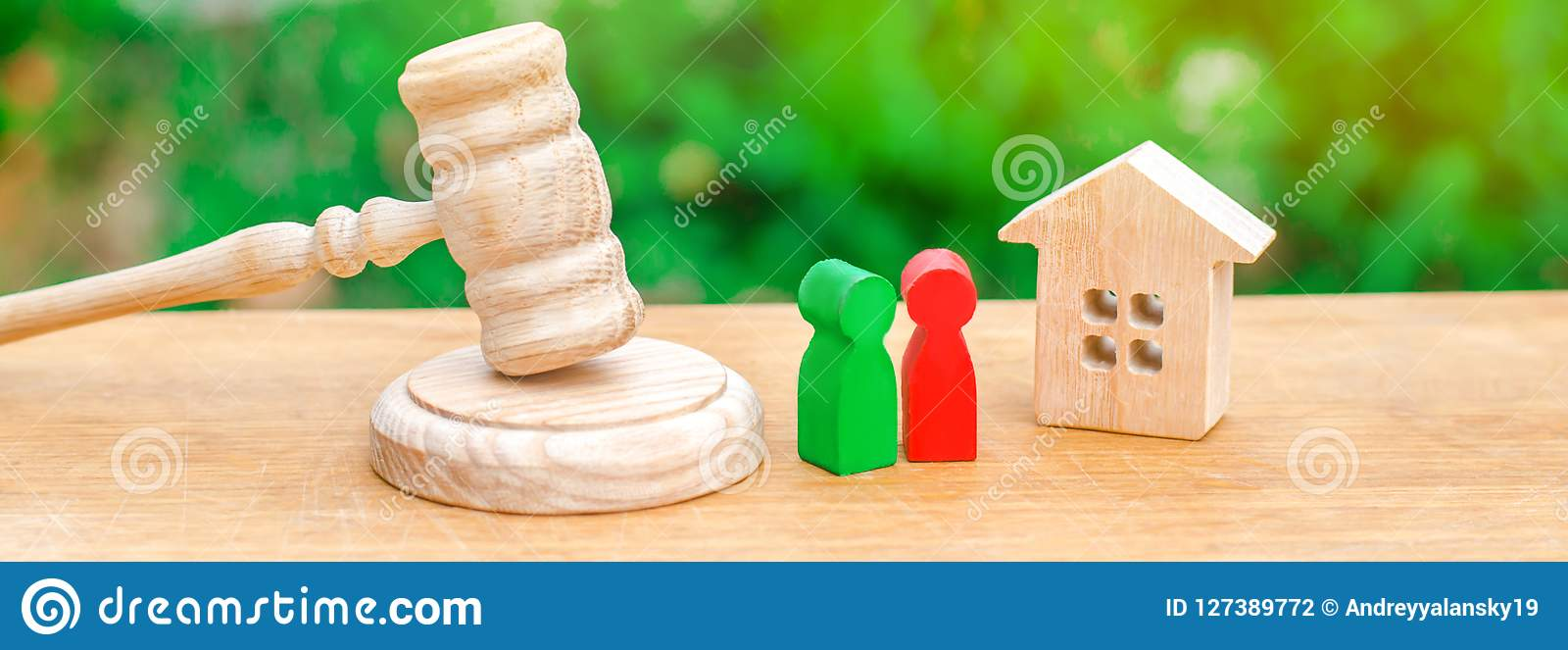 House, hammer of the judge with wooden figures of people. Clarification of ownership of property. Concept settlement of litigation