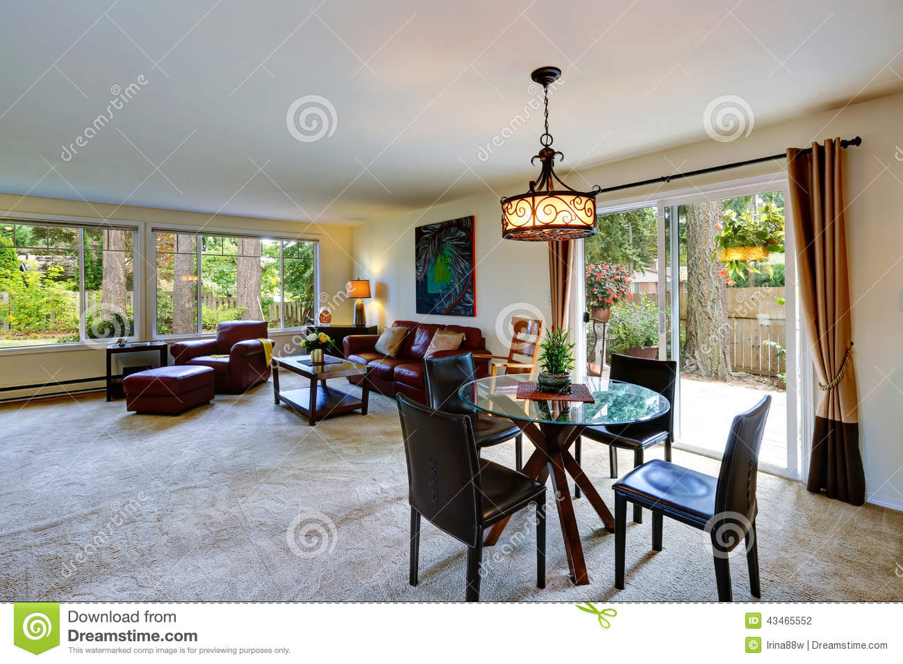 house interior with open floor plan. living room with dining area