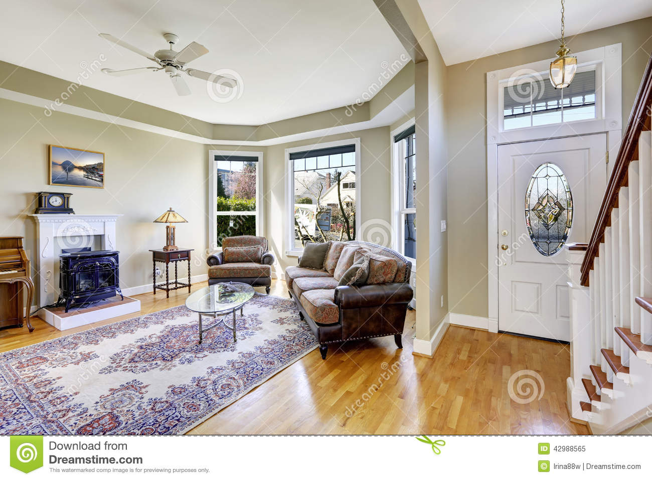 house interior with open floor plan living room and entrance ha stock