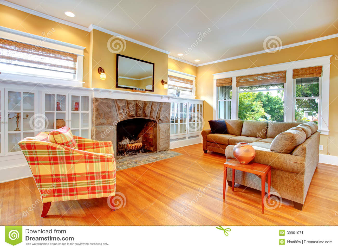 house interior yellow living room with fireplace stock image