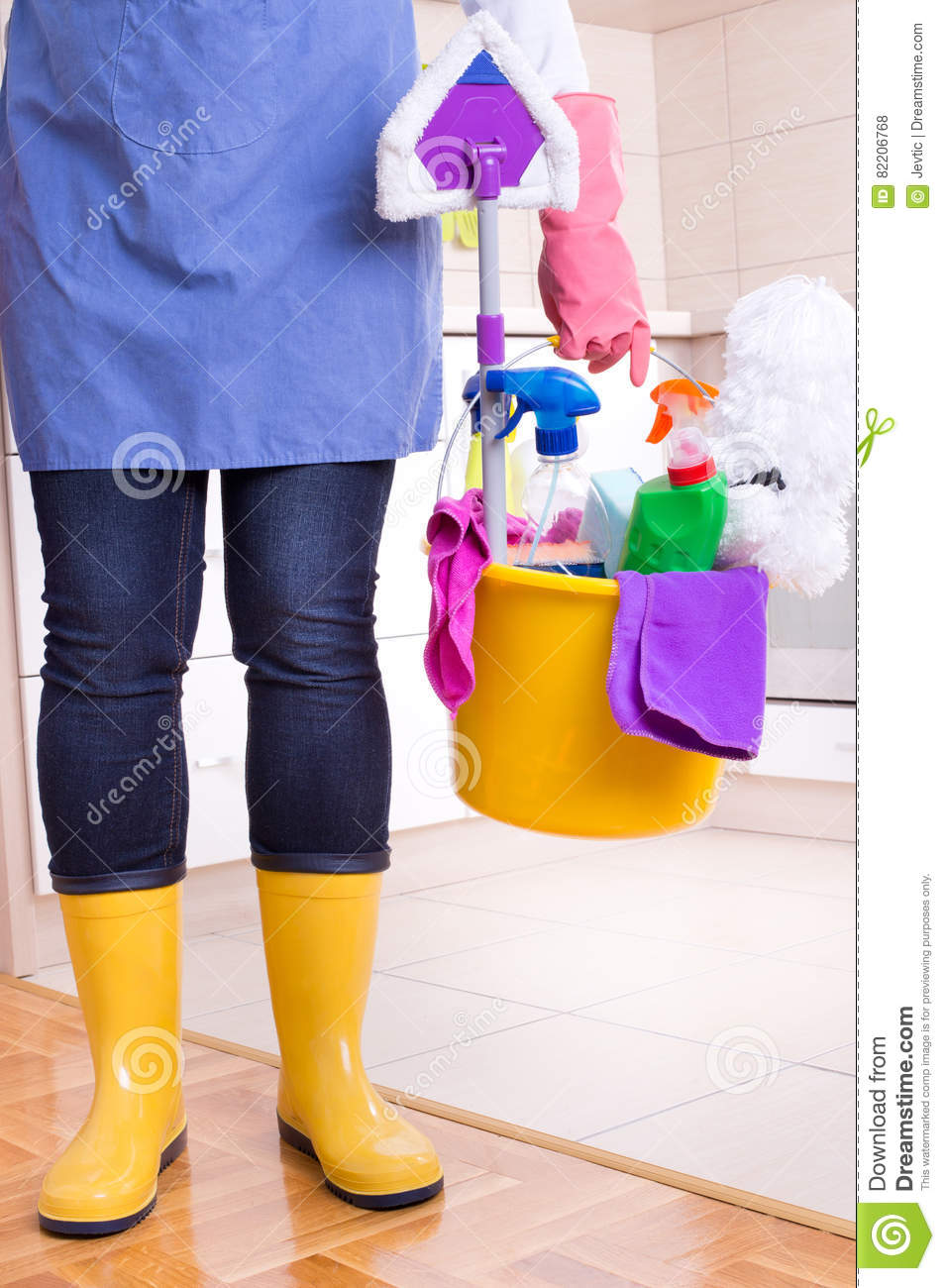 House keeper with cleaning equipment in bucket