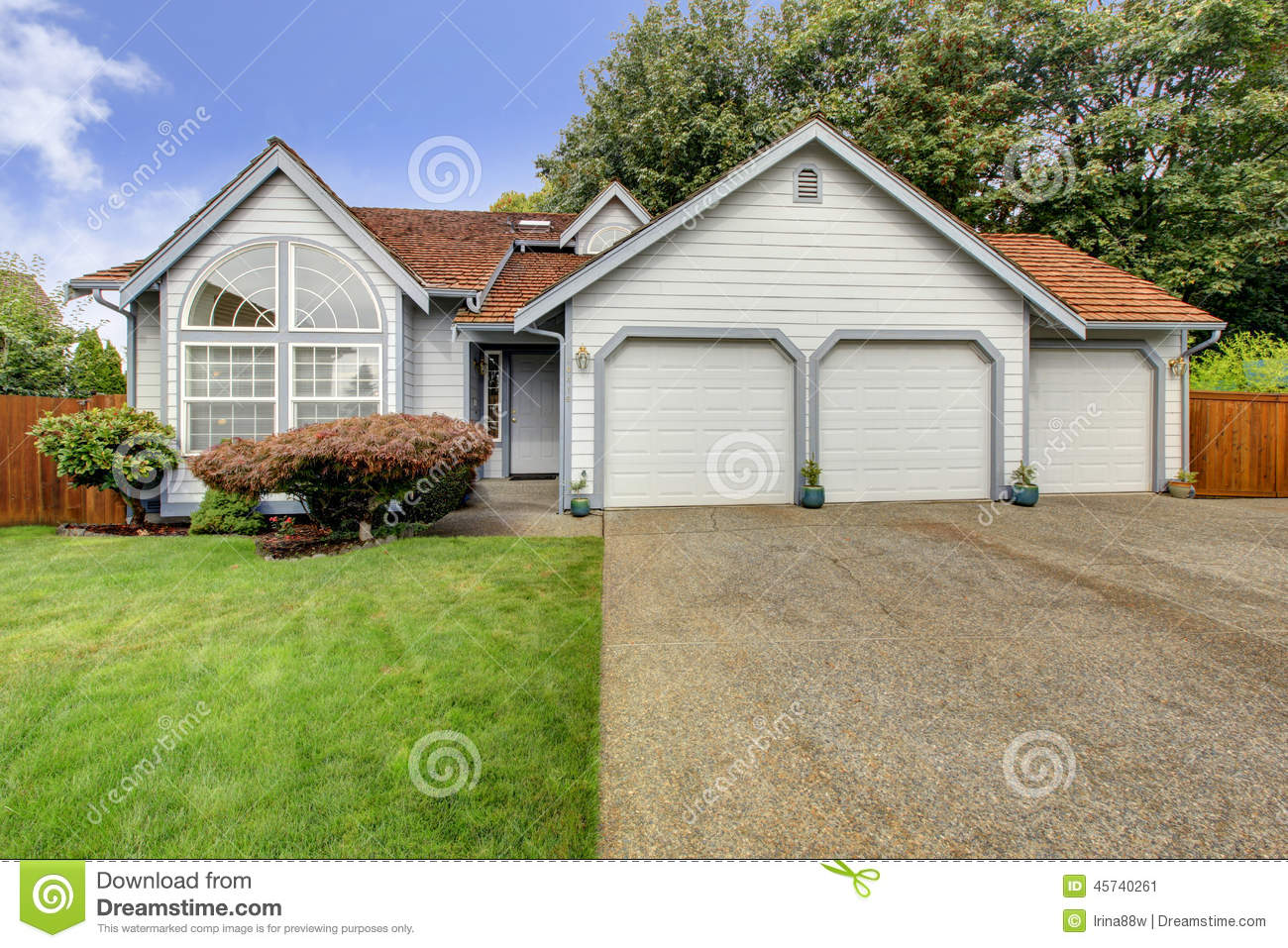 House with large arch window and three car garage stock for How big is a 2 car garage