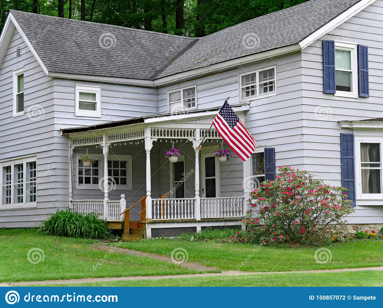 House with large porch and American flag