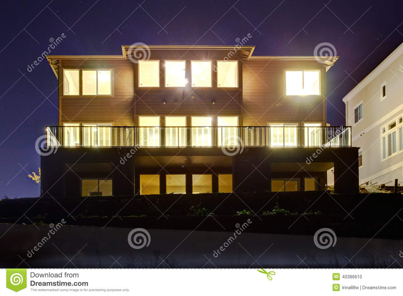 House With Lights On  Night View Stock Photo