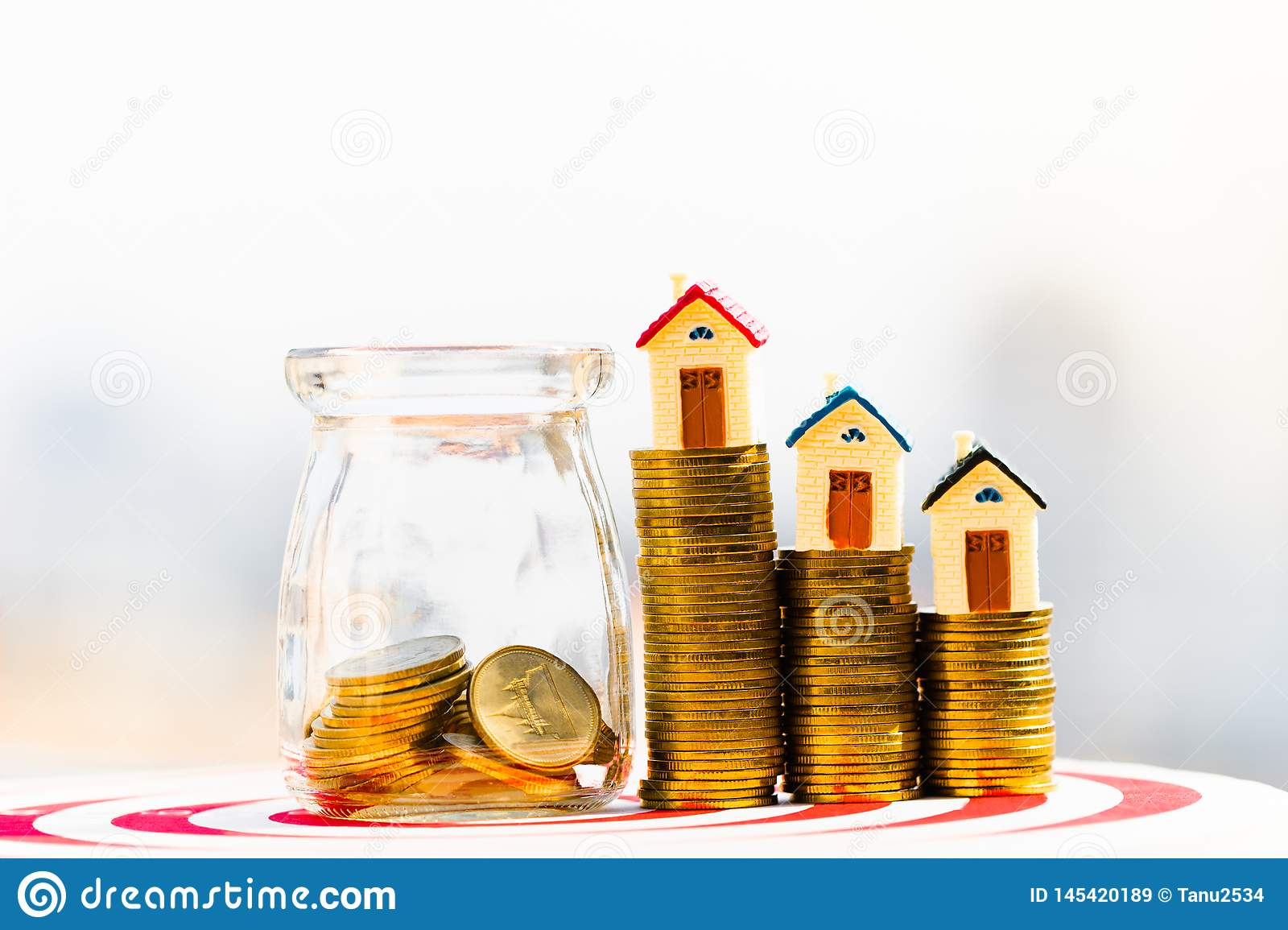 House model on coins stack. planning savings money of coins to buy a home concept.