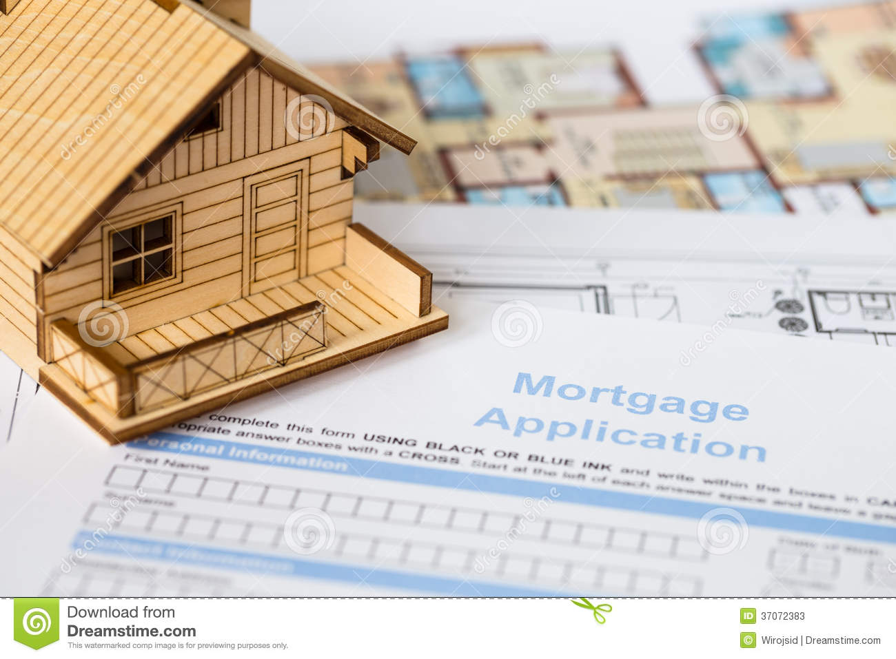 House mortgage application with model house stock image for Building a house loan options