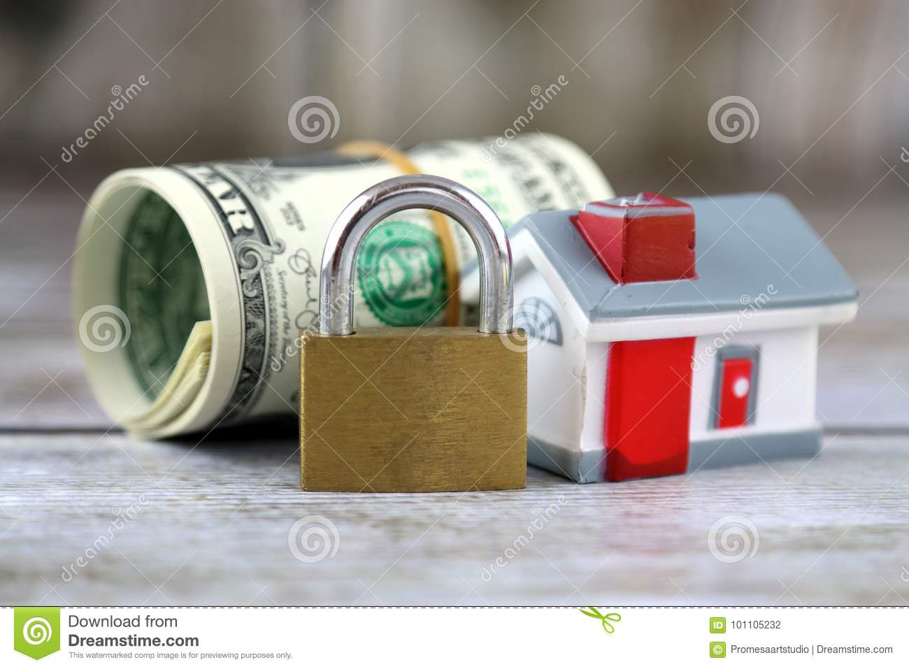 House, padlock and dollars. Conceptual image for investors in real estate and dollars. Security of money and real estate