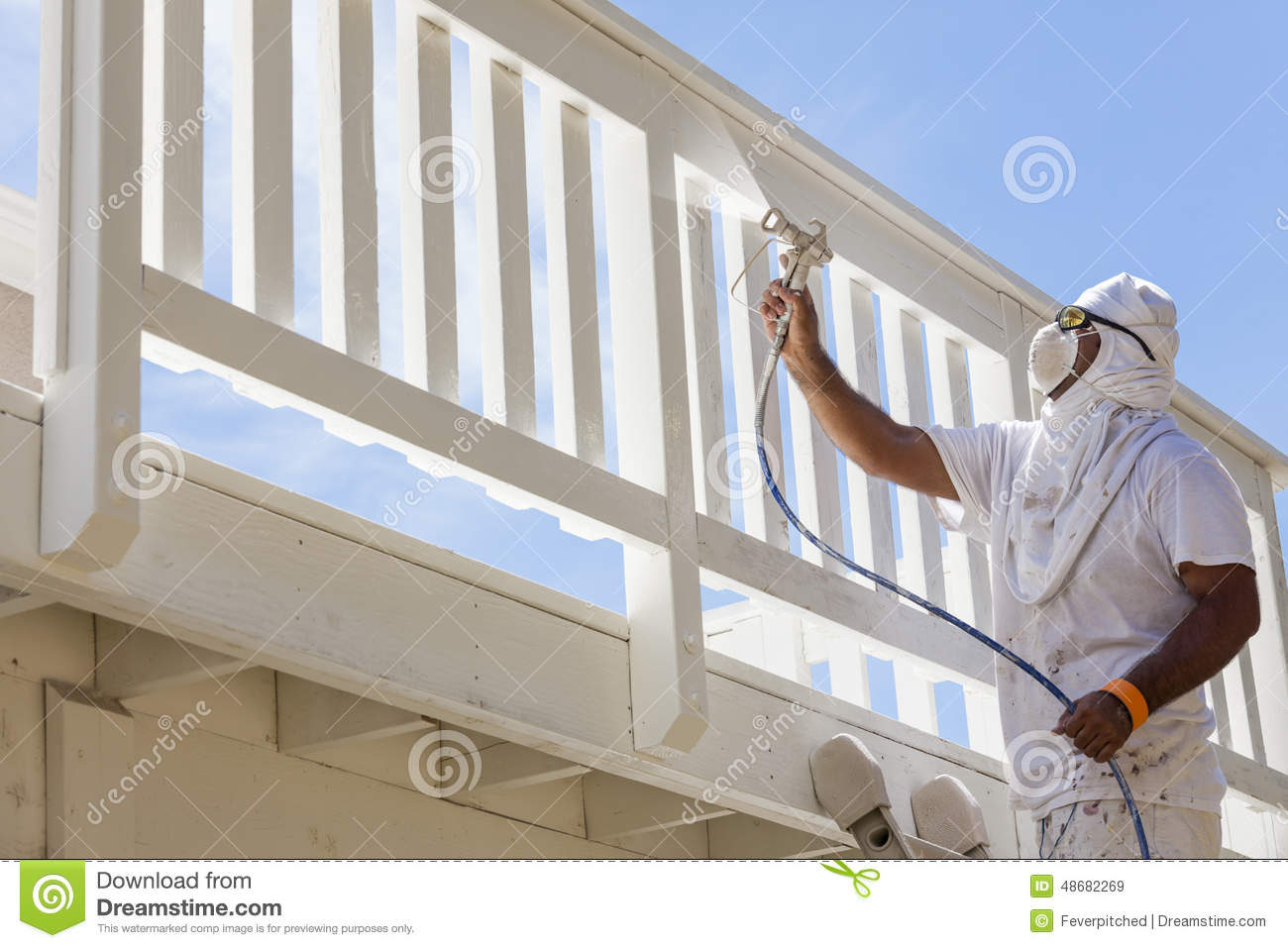 House Painter Spray Painting A Deck Of A Home Stock Photo Image 48682269