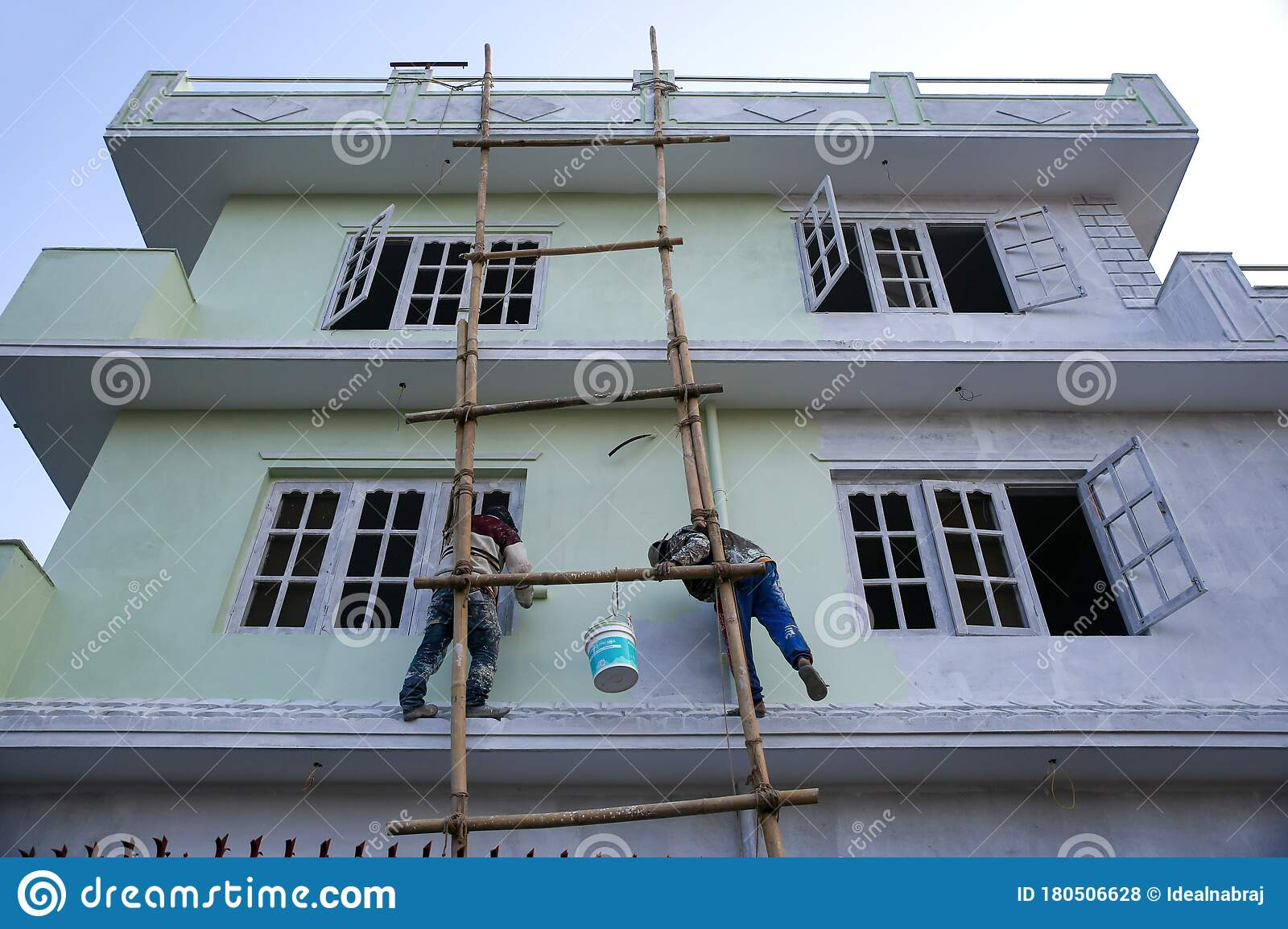 House Painters Painting Outside Of The House With Paint Brush Roller And Bamboo Ladder Editorial Stock Photo Image Of Abstract Construction 180506628