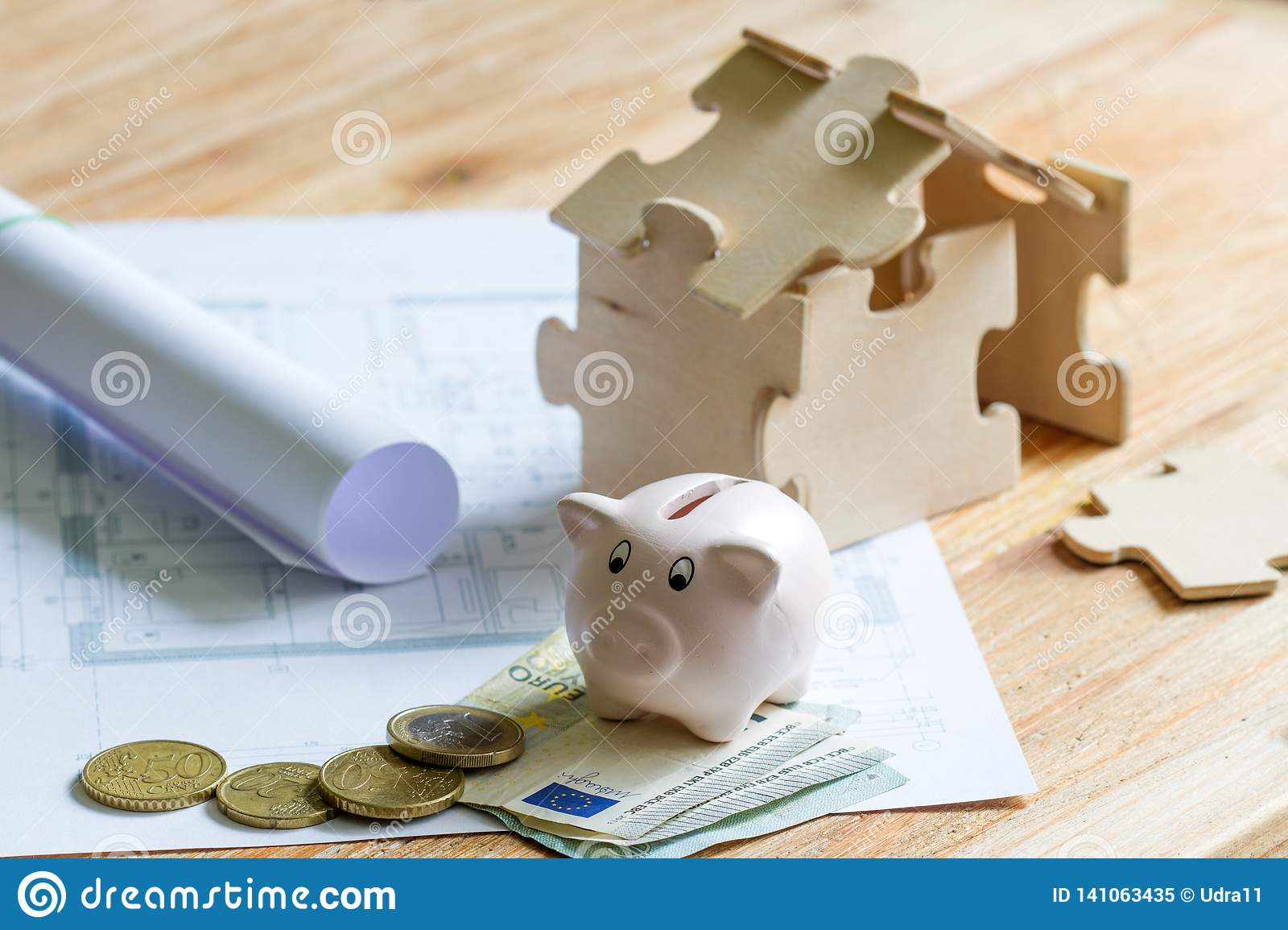 House with puzzles and planning expenses for building a house abstract concept