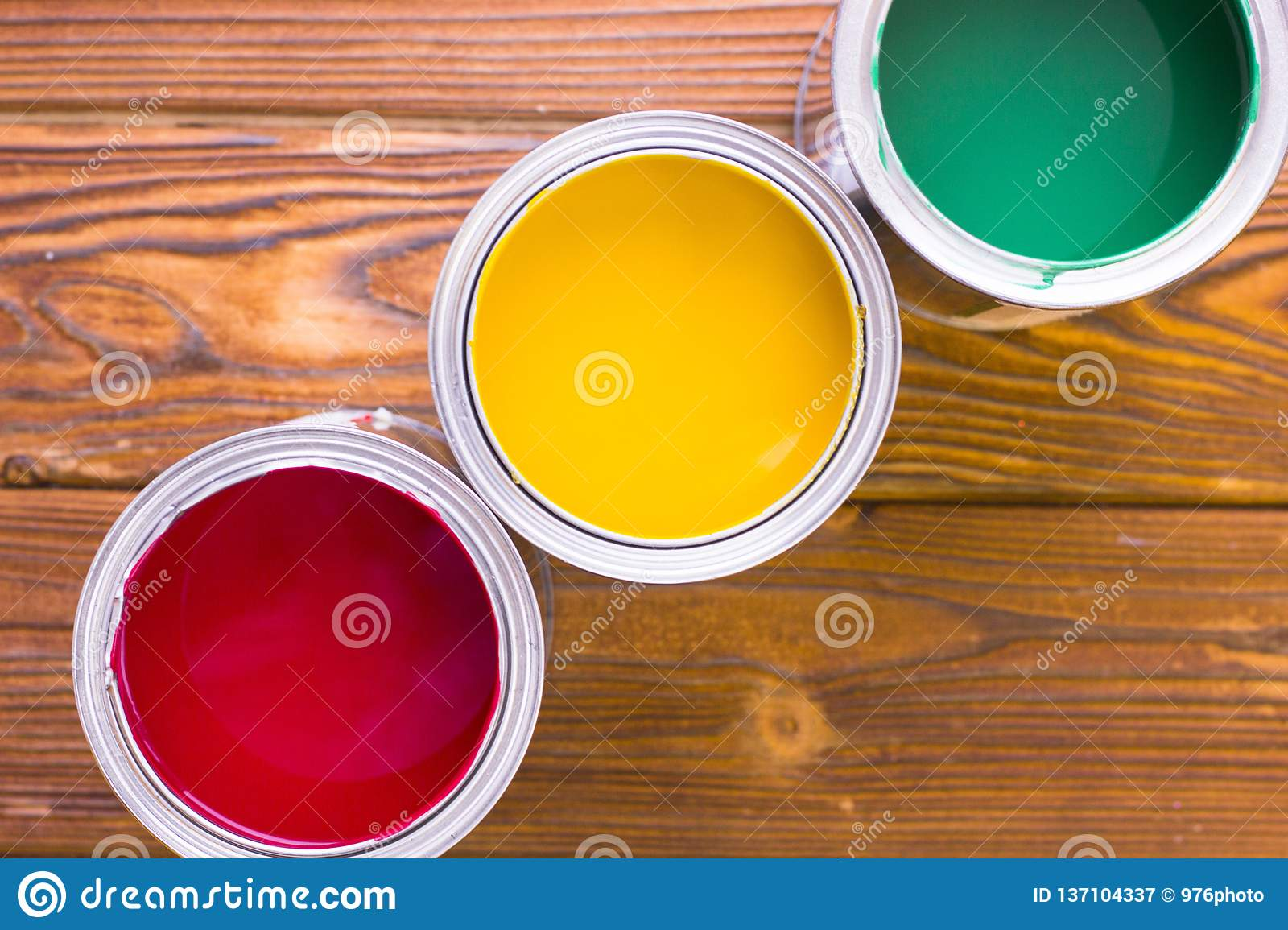 House renovation concept, colorfull paint cans on dark wooden background