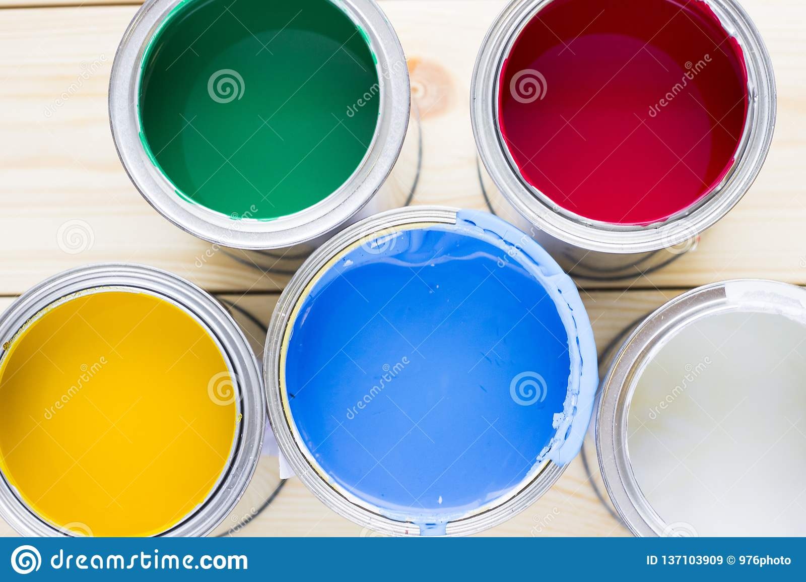 House renovation concept, colorfull paint cans on wooden background