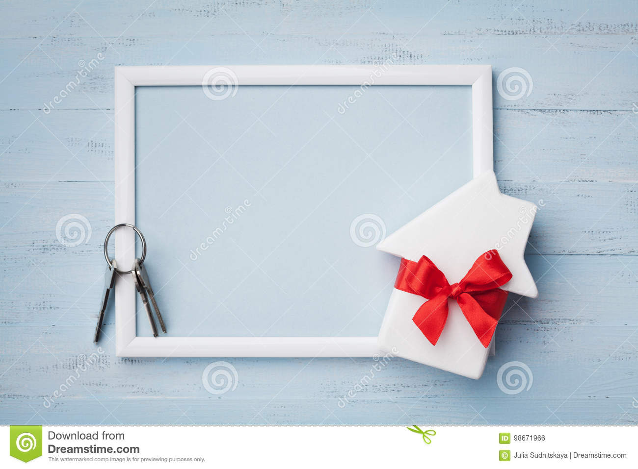 Homewarming Gift House With Ribbon Frame And Keychain On Wooden Background
