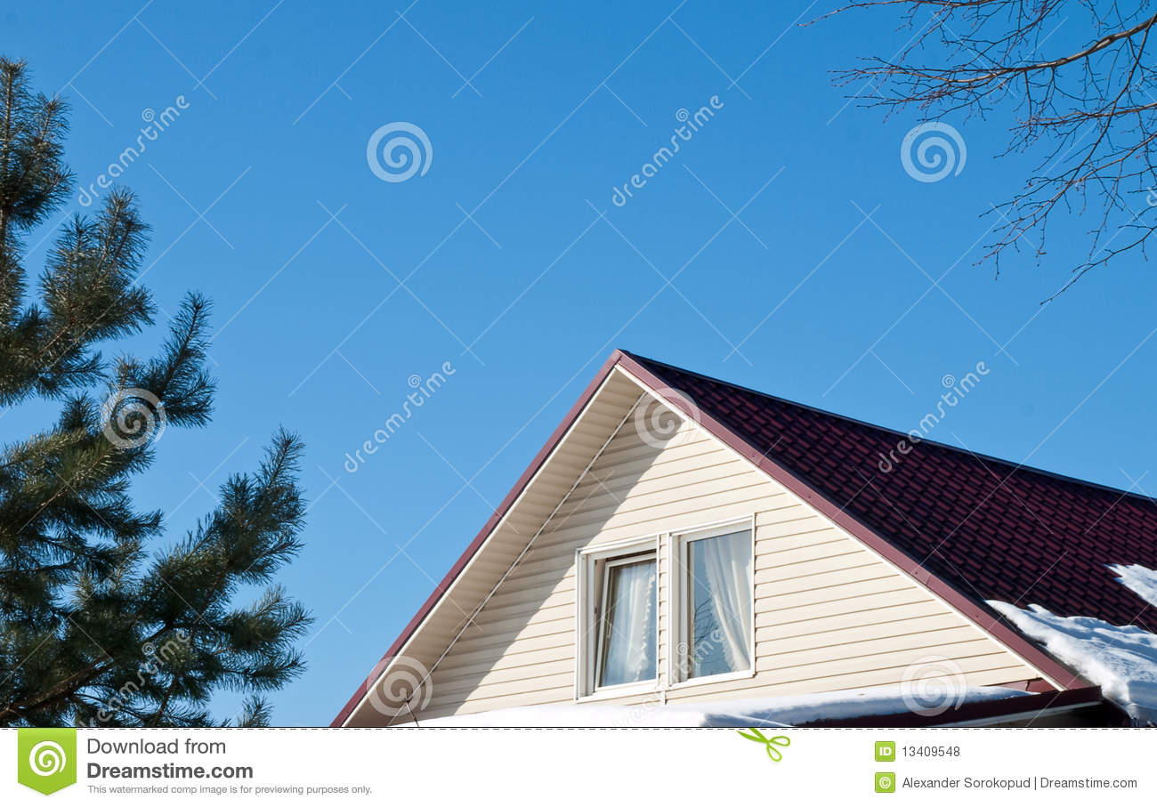 House Roof On Blue Background Royalty Free Stock Photos
