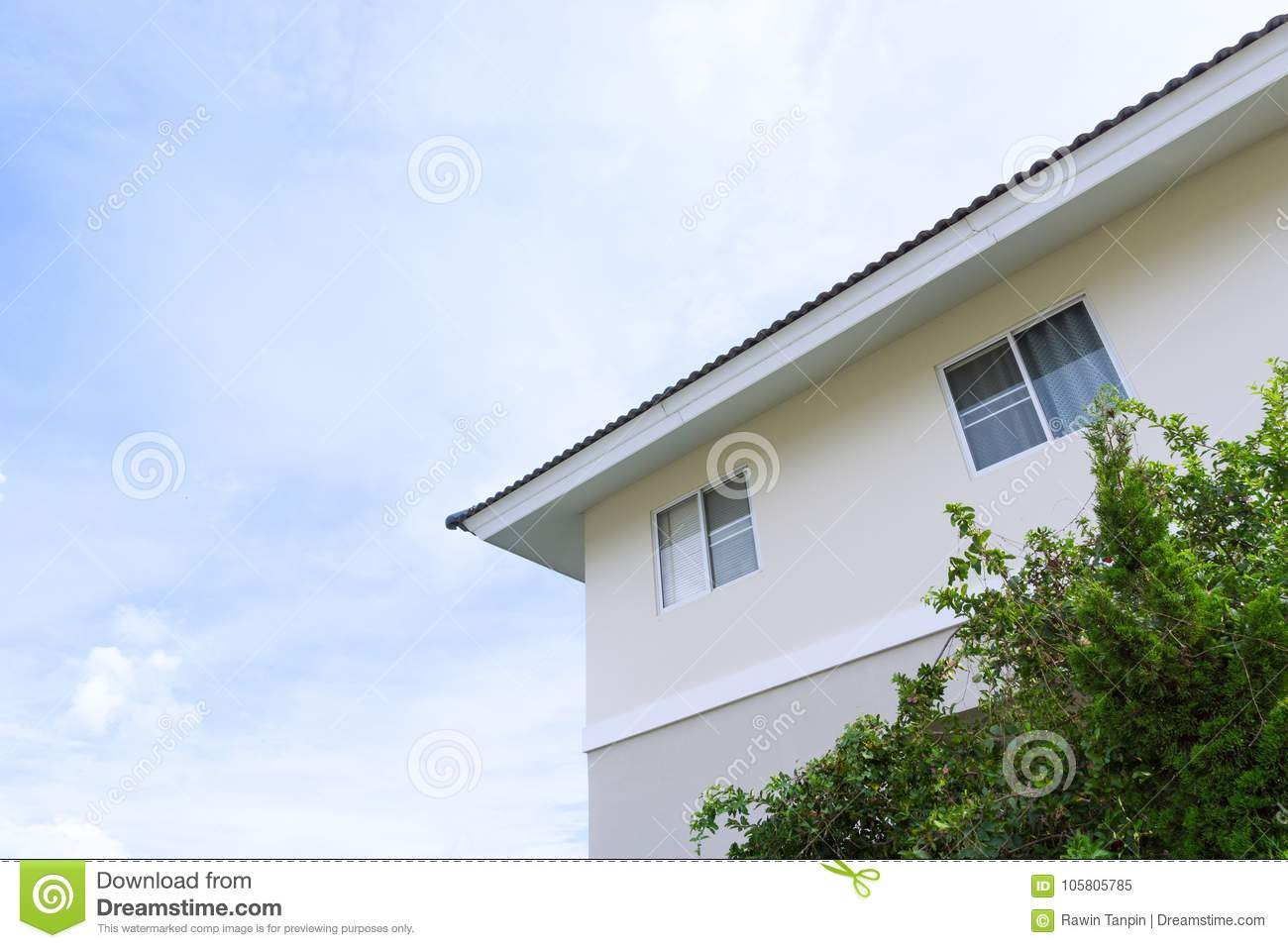 House roof with large windows on blue sky background