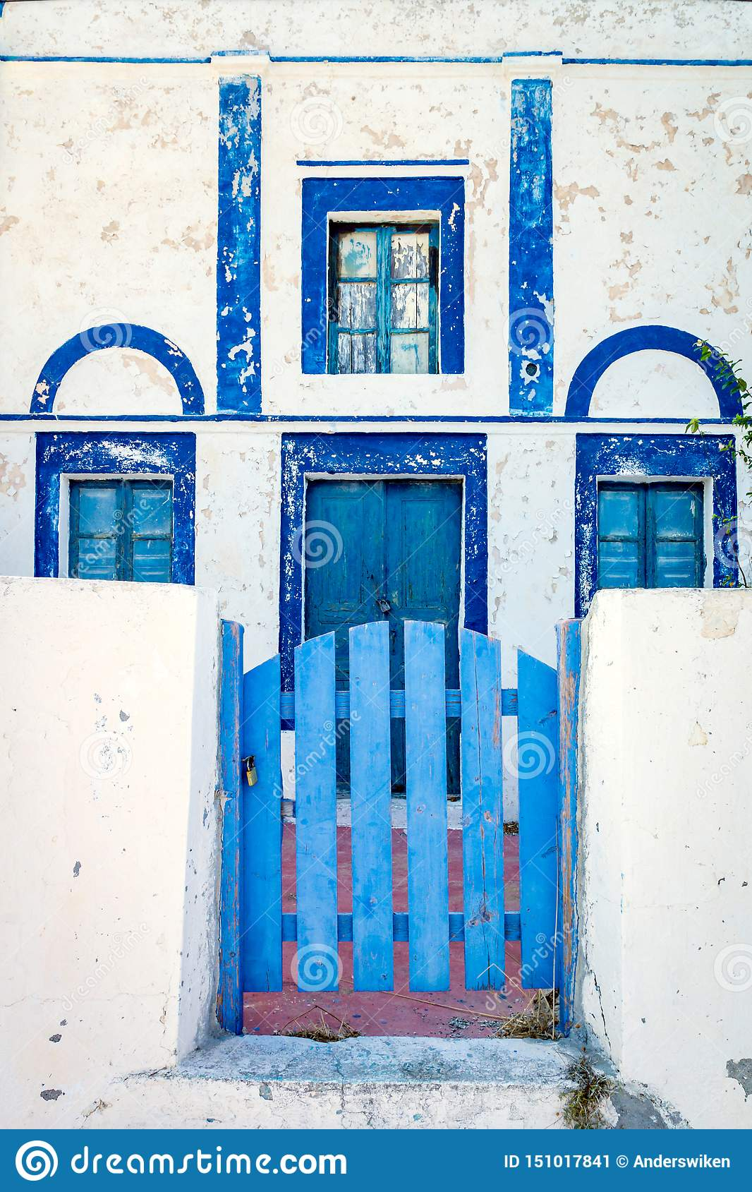 House in Santorini/Greece with blue doors and windows.