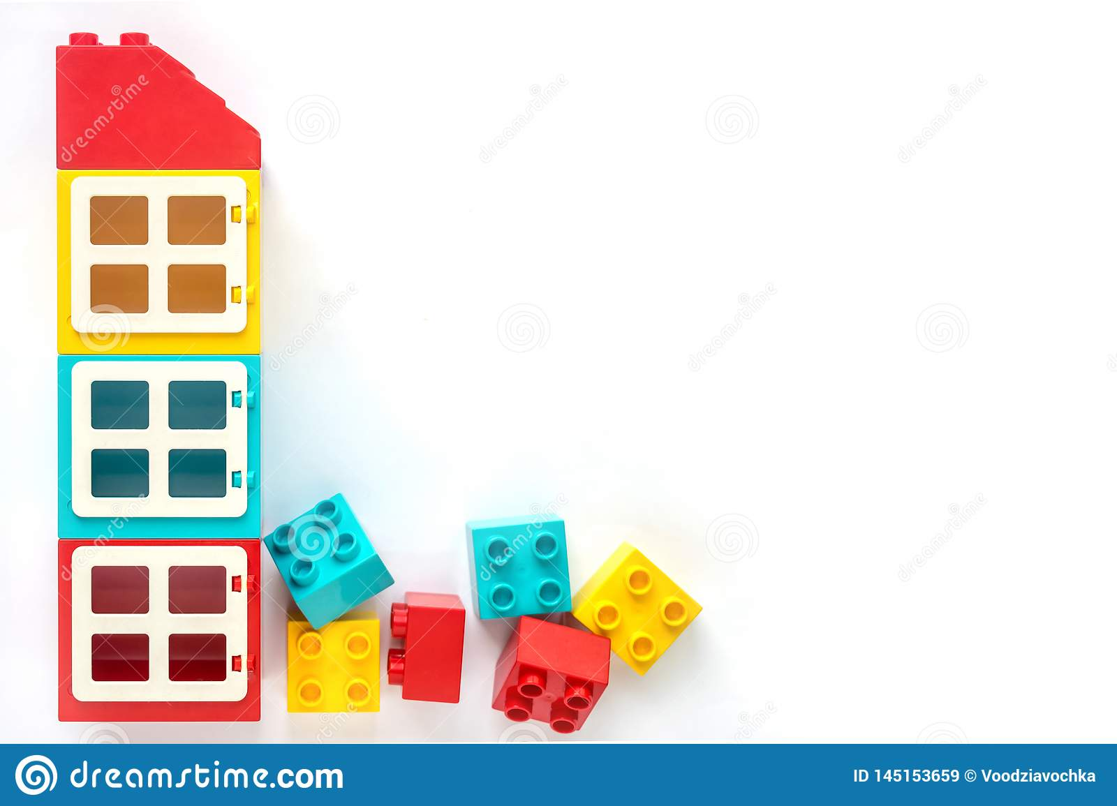 Lego bricks. House of Small and big plastic constructor bricks on white background. Popular toys. Free space for text
