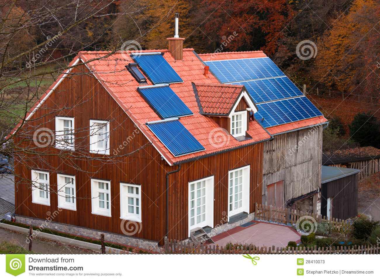 House with solar panels sun heating system on roof stock for Heating systems for houses