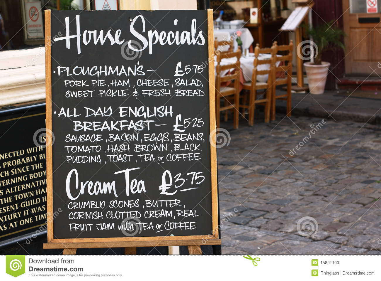 House specials menu board in england with a street cafe in the