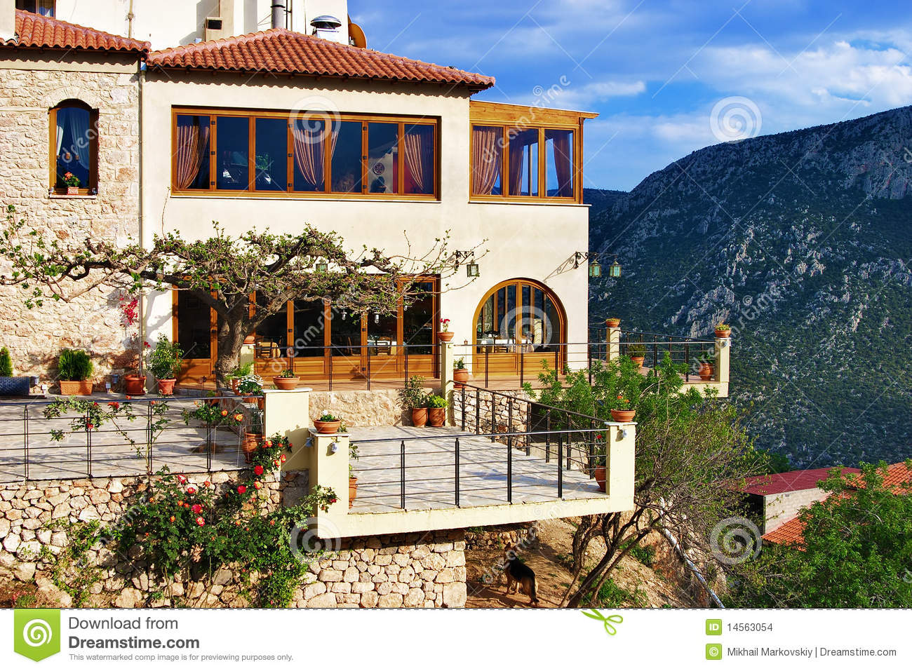 House on a steep slope of mount parnassus delphi stock for Cost of building on a steep slope