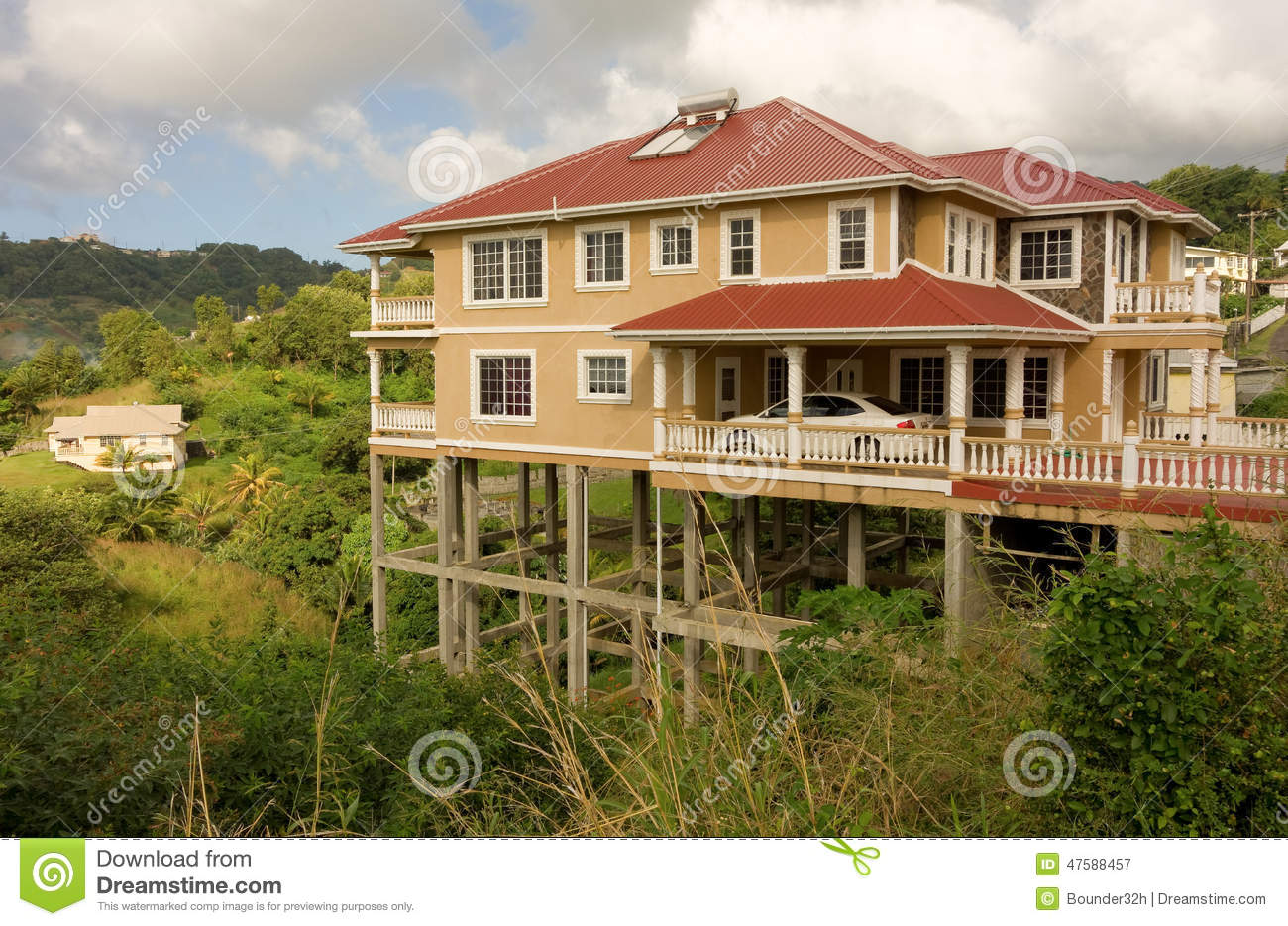 A house on stilts in the caribbean stock image image for Cost of building on a steep slope