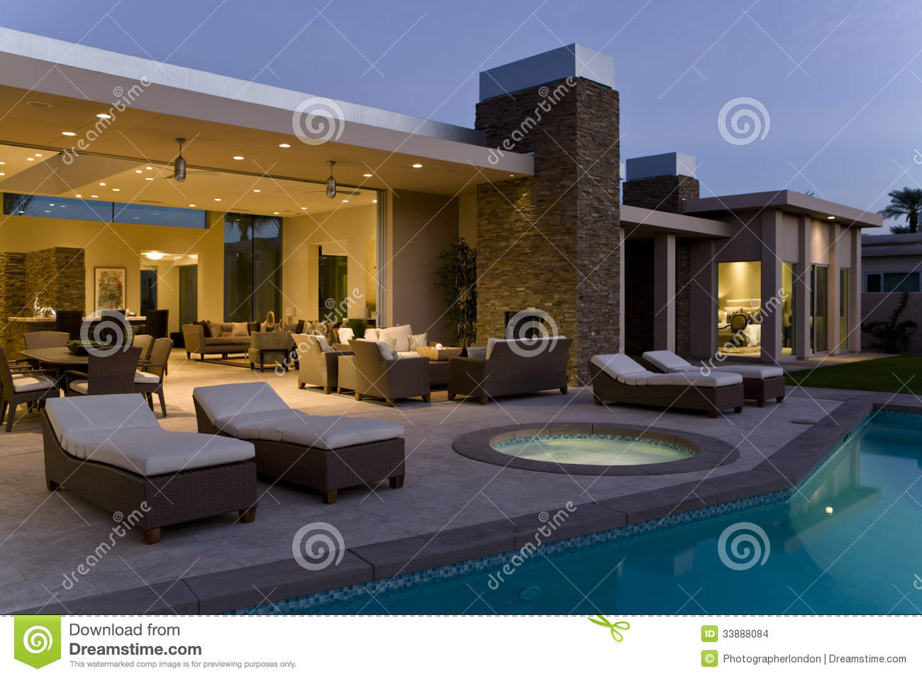 patio with pool.  Pool House With Sunloungers On Patio By Pool At Dusk And