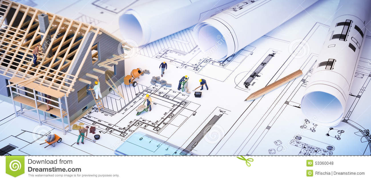 House under construction on blueprints stock photo image for Home construction project plan
