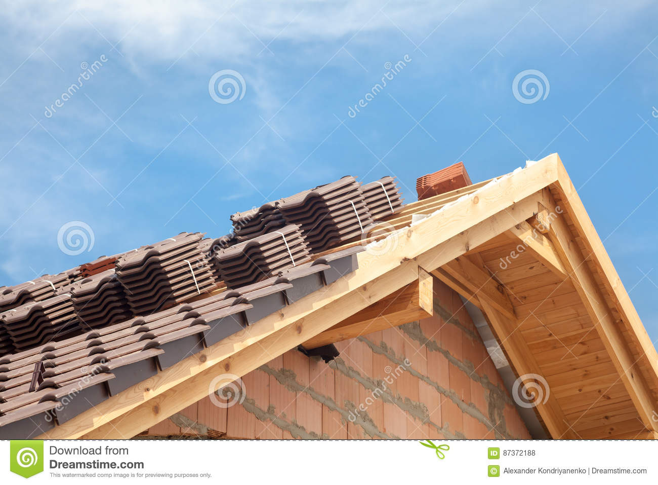 House under construction. Roofing tiles preparing to Install.