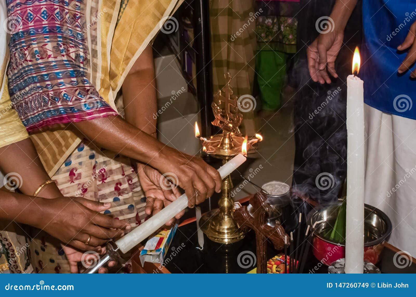 House warming rituals in Kerala Malankara Orthodox church - Lighting up Nilavilakku with candle