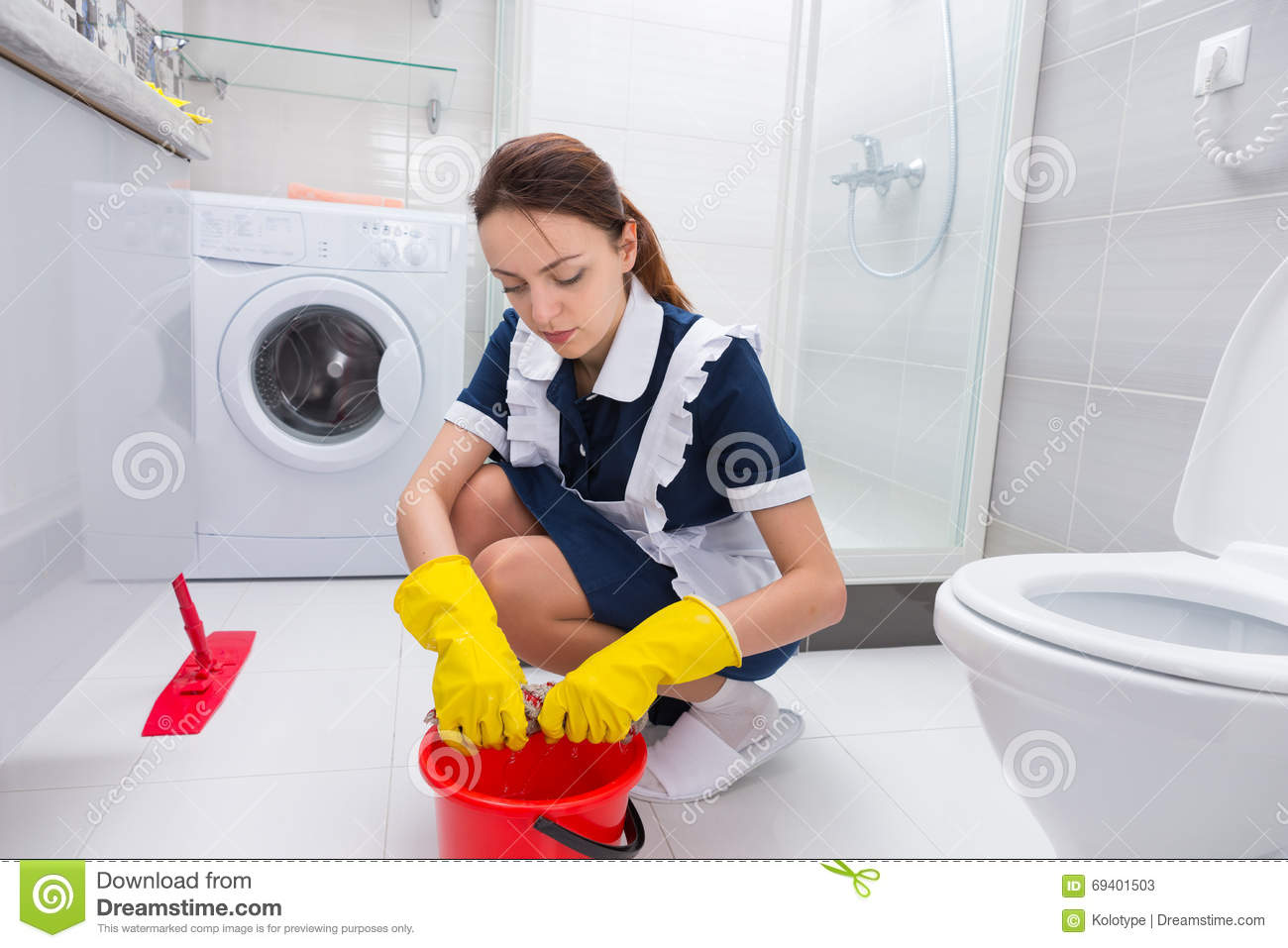Housekeeper cleaning a bathroom floor stock photo image for Floor clean out