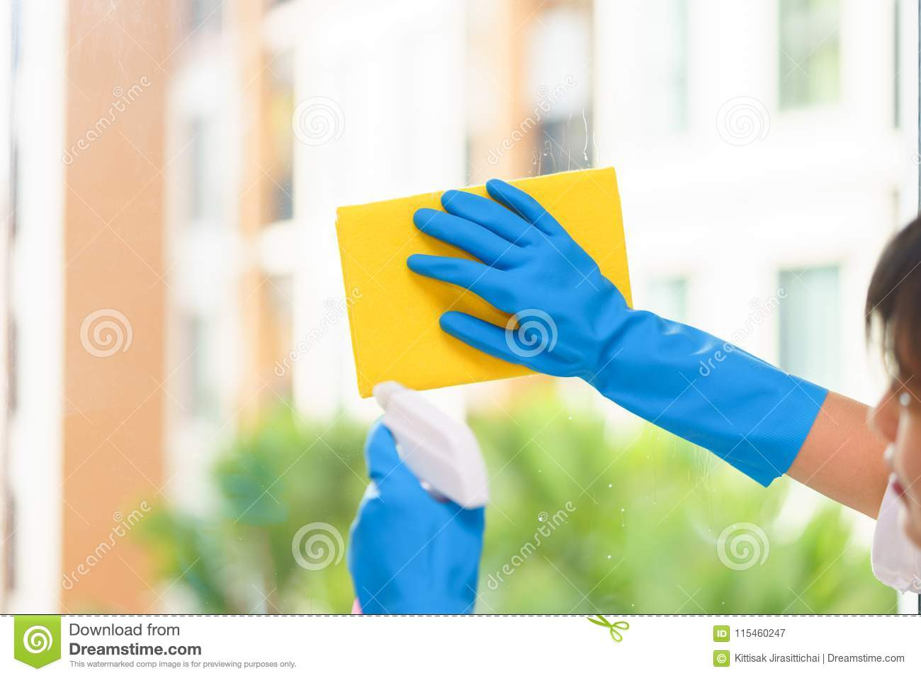 Housekeeper Cleaning Mirror With Yellow Cloth Stock Image Image Of
