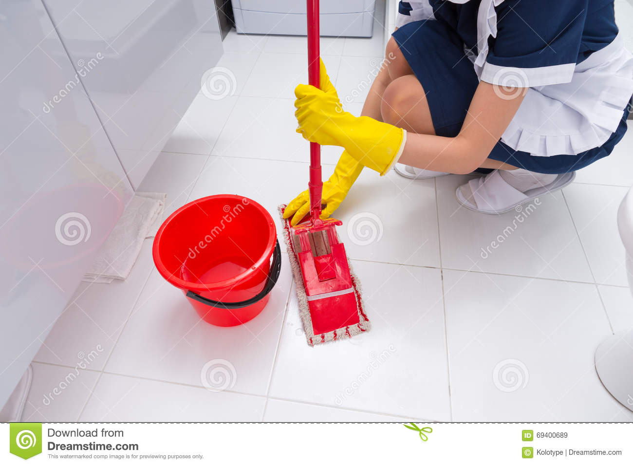 Housekeeper Fitting A Clean Cloth To A Mop Stock Image