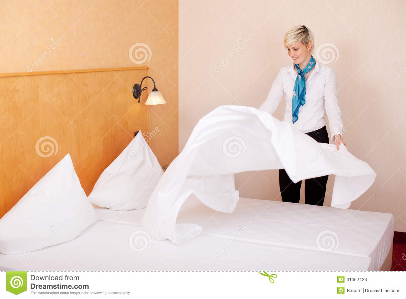 Housekeeper Making Bed In Hotel Room Stock Photo Image