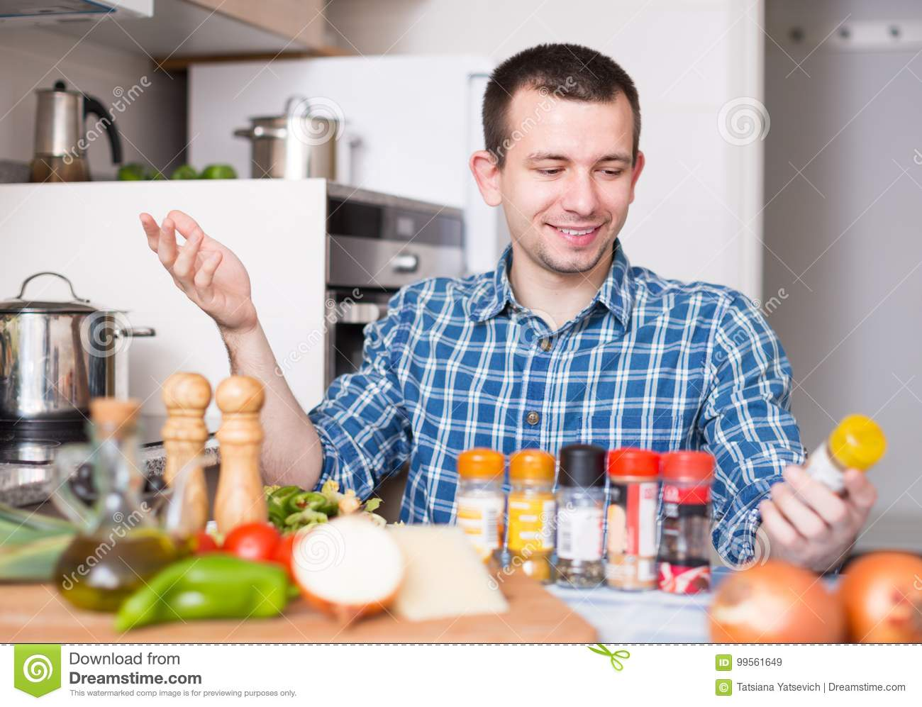 Normal Guy Chooses Spices In The Kitchen At Home Stock Image - Image ...