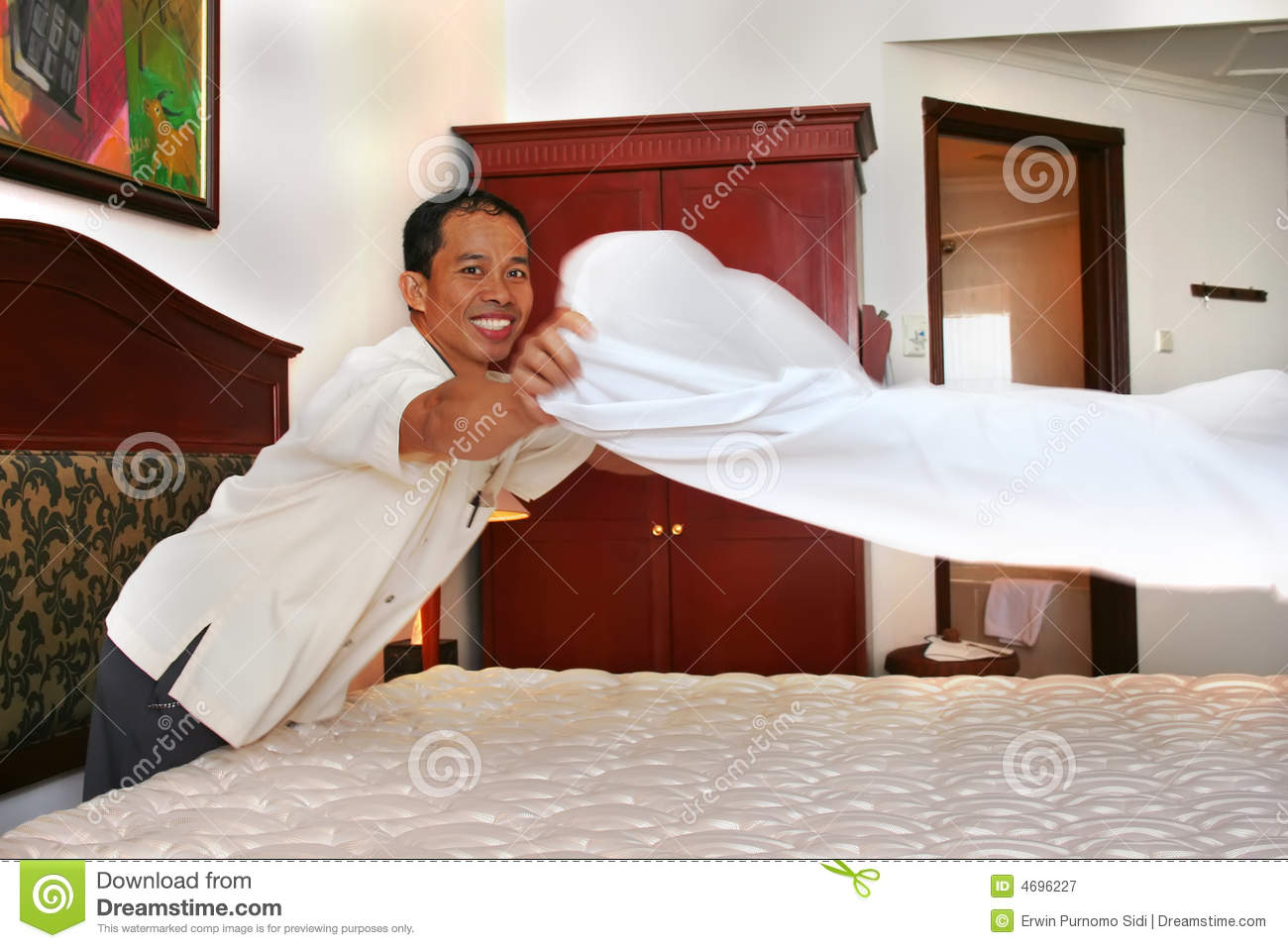 housekeeping or room boy with big smille royalty free stock pography