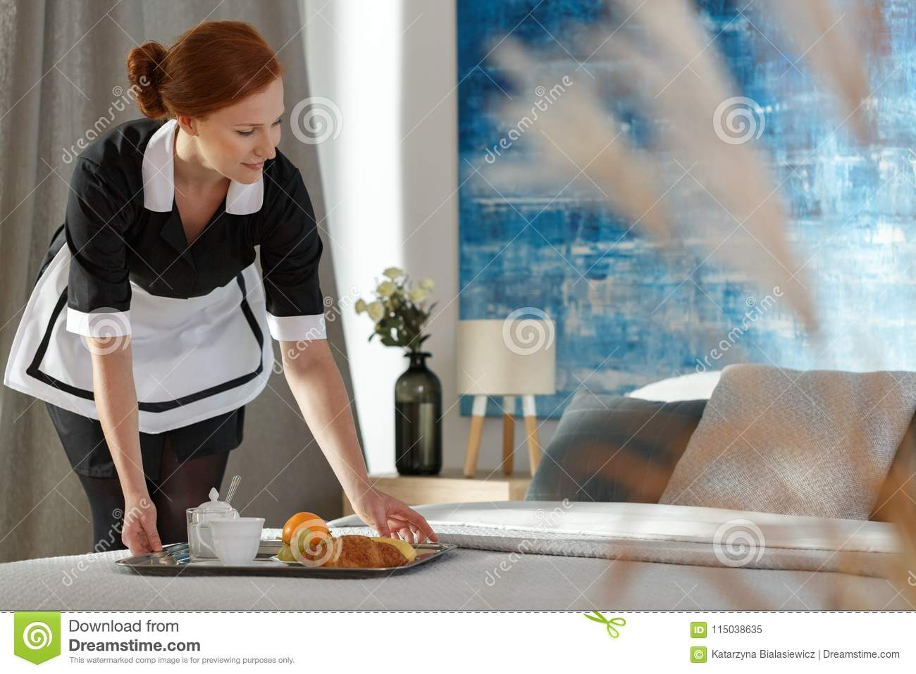 Housemaid putting tray with food