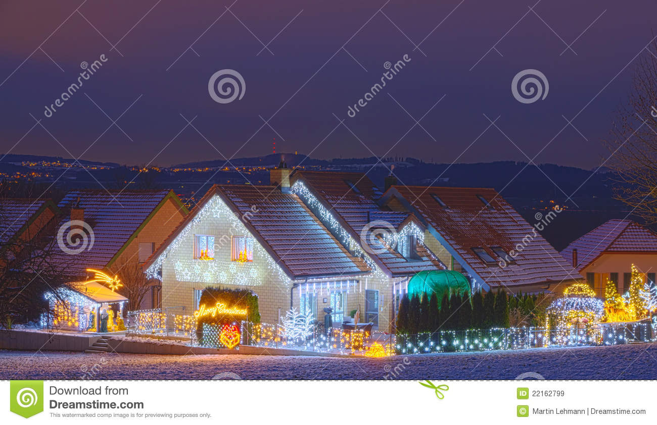 Houses decorated with christmas lights royalty free stock