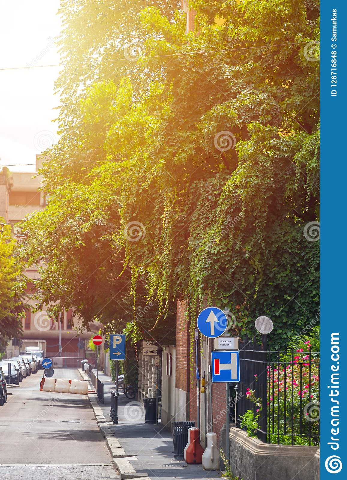 Houses With Flowers On The Windows In Milan Italy Stock