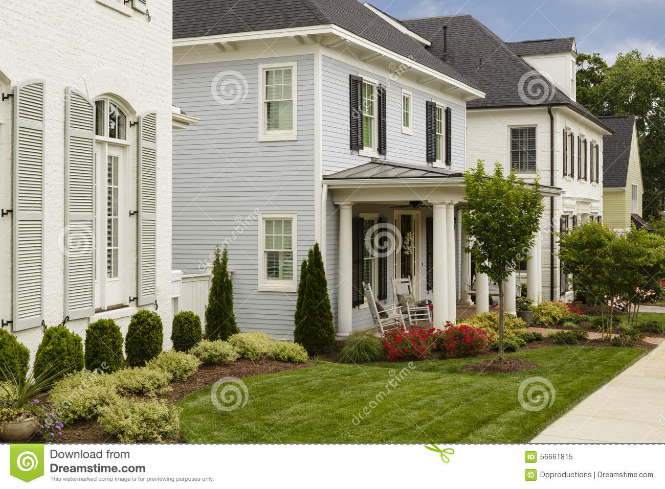 Houses With Manicured Lawns Stock Photo
