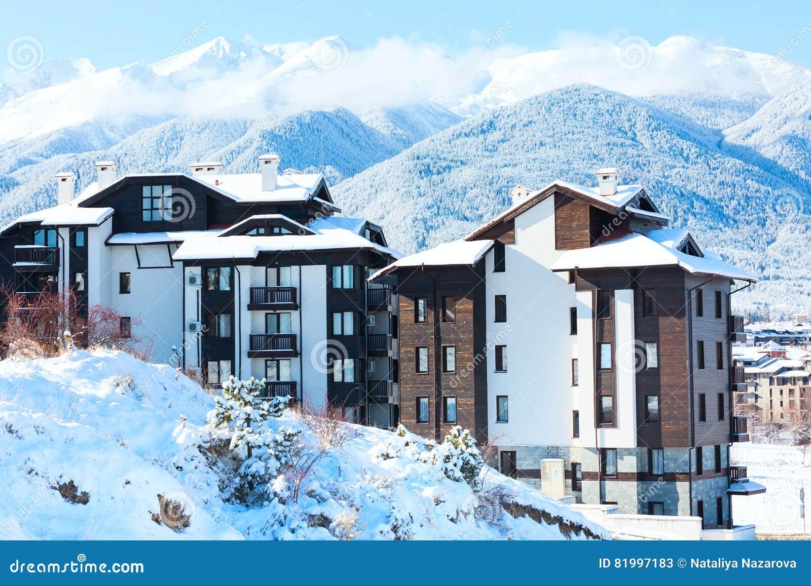 Houses And Snow Mountains Panorama In Bulgarian Ski Resort