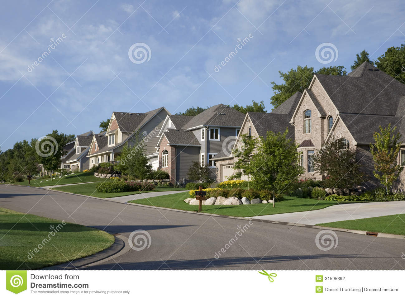 Houses On Upscale Suburban Street In Morning Sunlight Stock