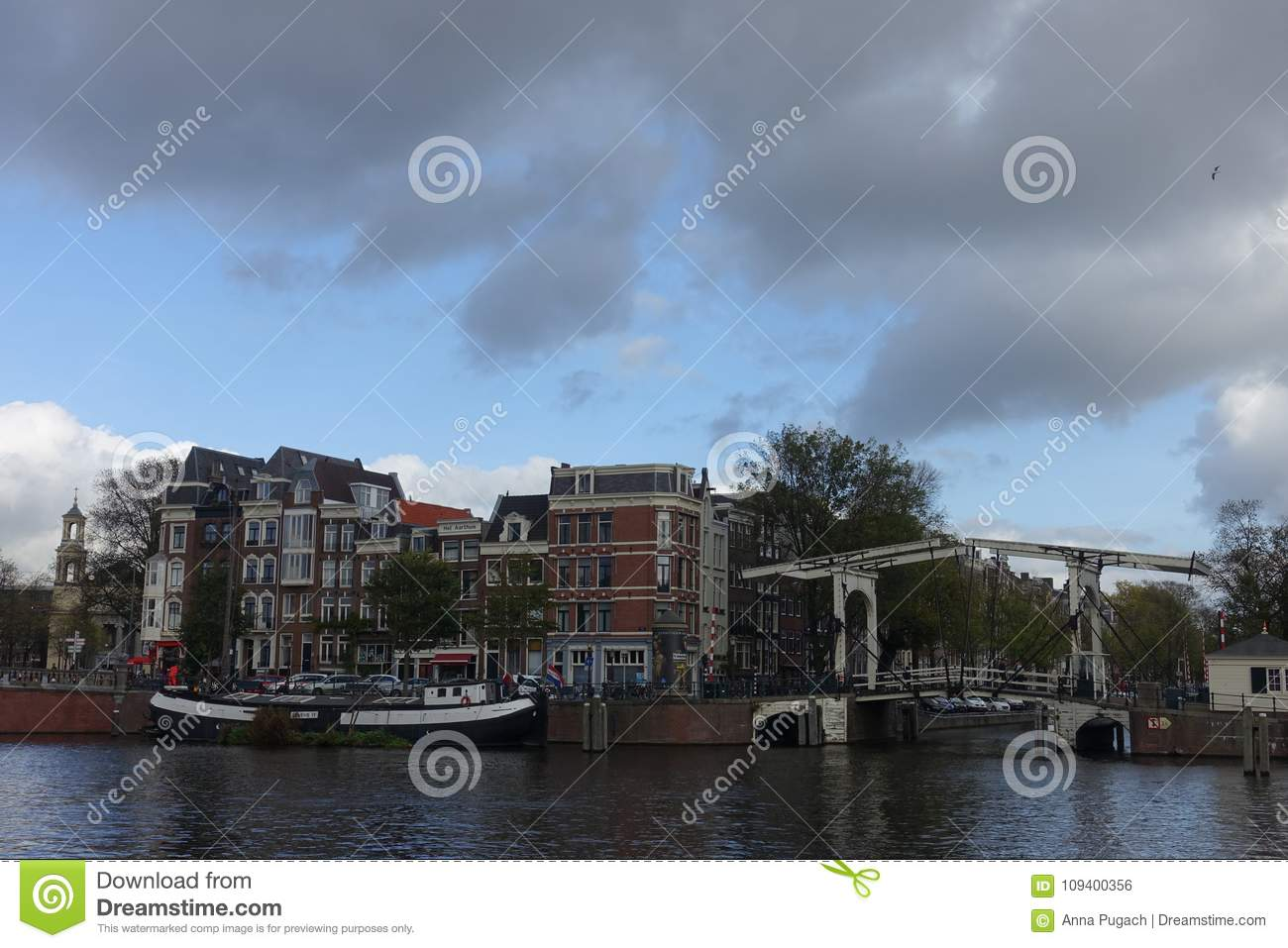 Houses and Walter Suskindbrug next to Amstel river in Amsterdam