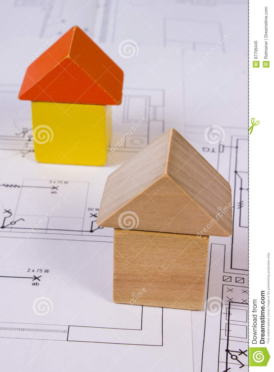 Houses Of Wooden Blocks On Construction Drawing Of House Building