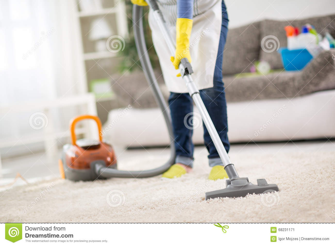Housewife Clean Carpet With Vacuum Cleaner Stock Image