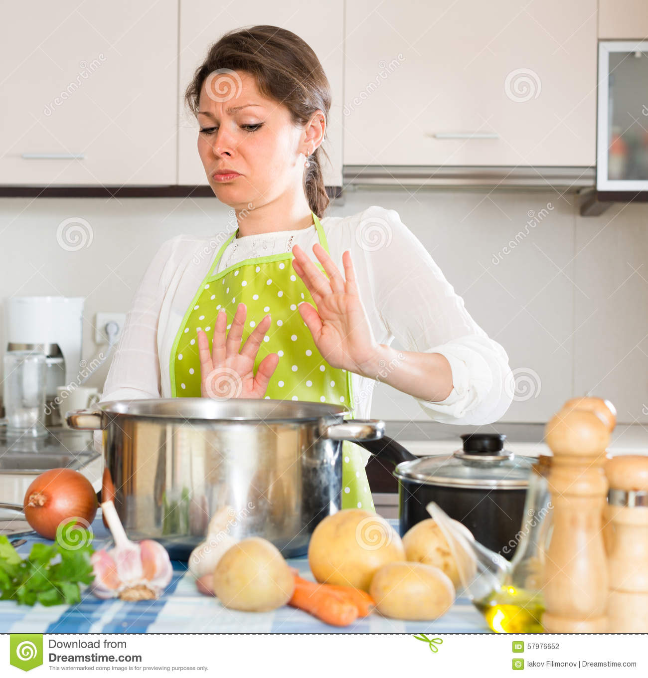 Housewife feeling bad smell from pan