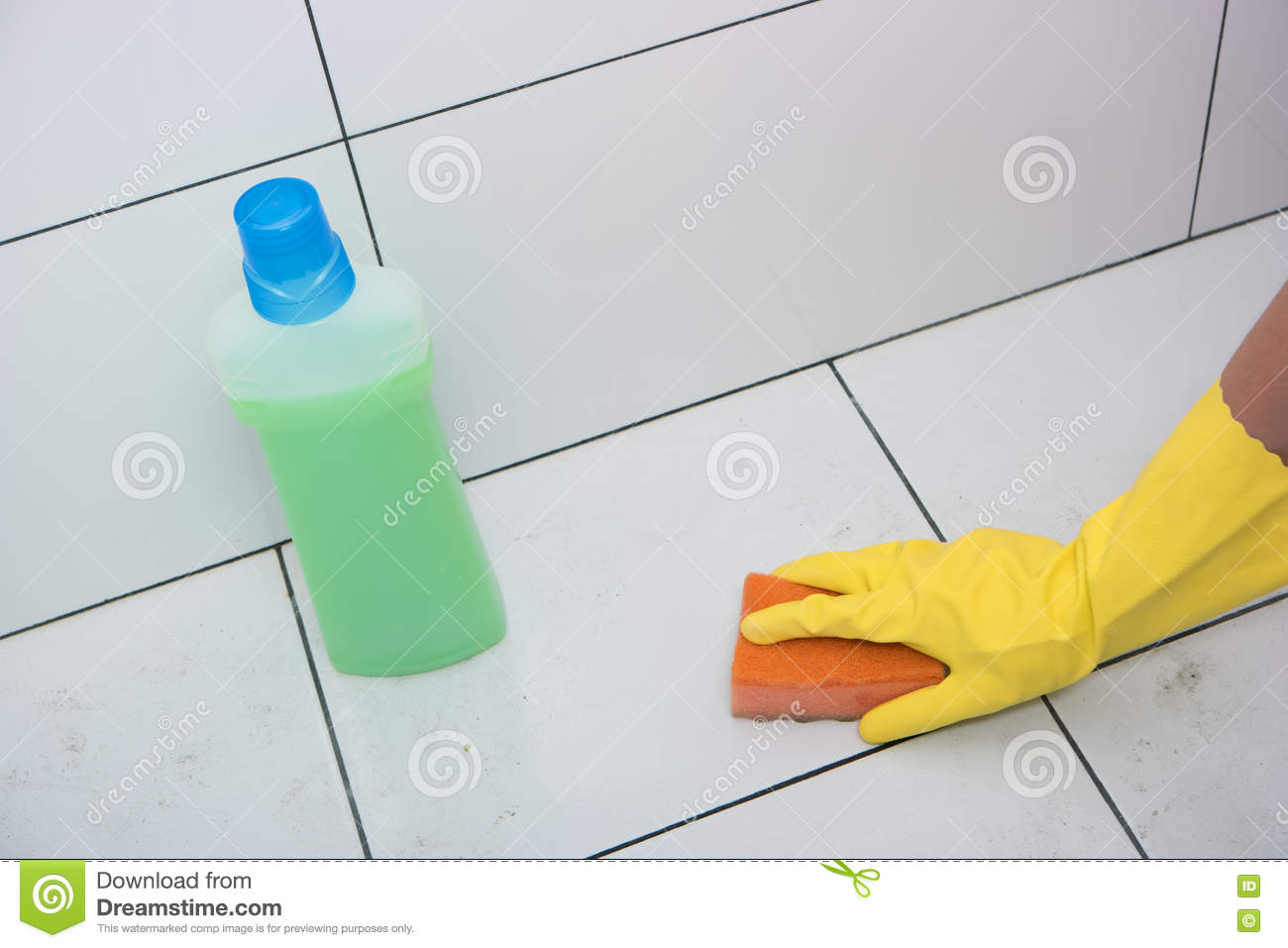 Housewife Hand In A Yellow Rubber Glove With Sponge. Stock Photo ...