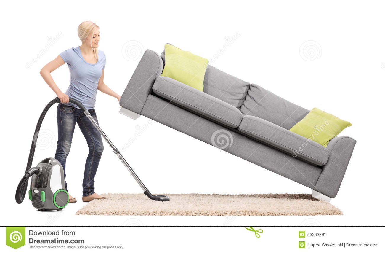 Strong Housewife Lifting A Sofa With One Hand And Vacuuming Underneath