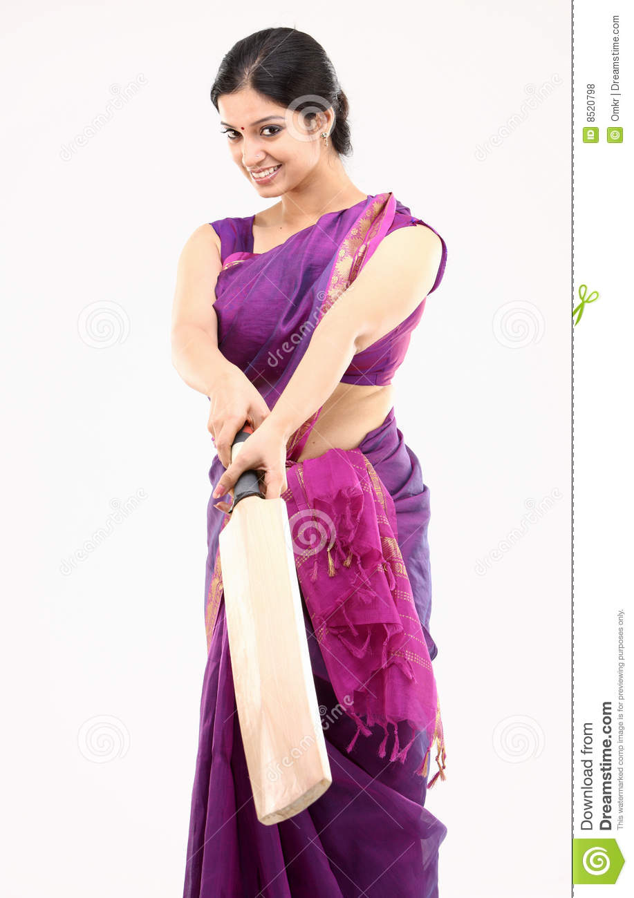 housewife in pink sari with the bat